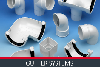 Various white guttering parts gathered
