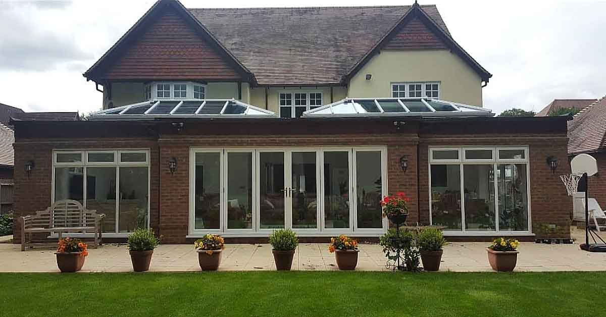 PVC bifolds doors installed 6m wide with roof lanterns and side windows.